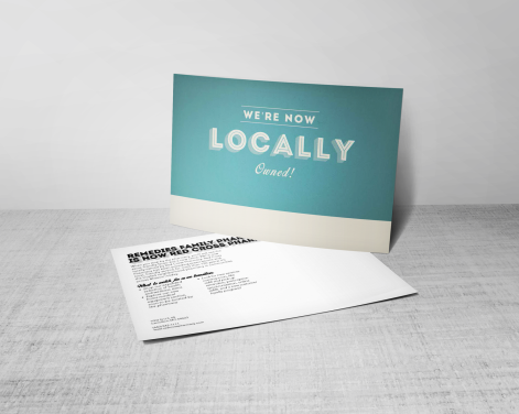locally_owned_postcard_display